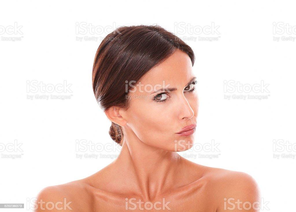 Unsmiling hispanic female looking at camera stock photo