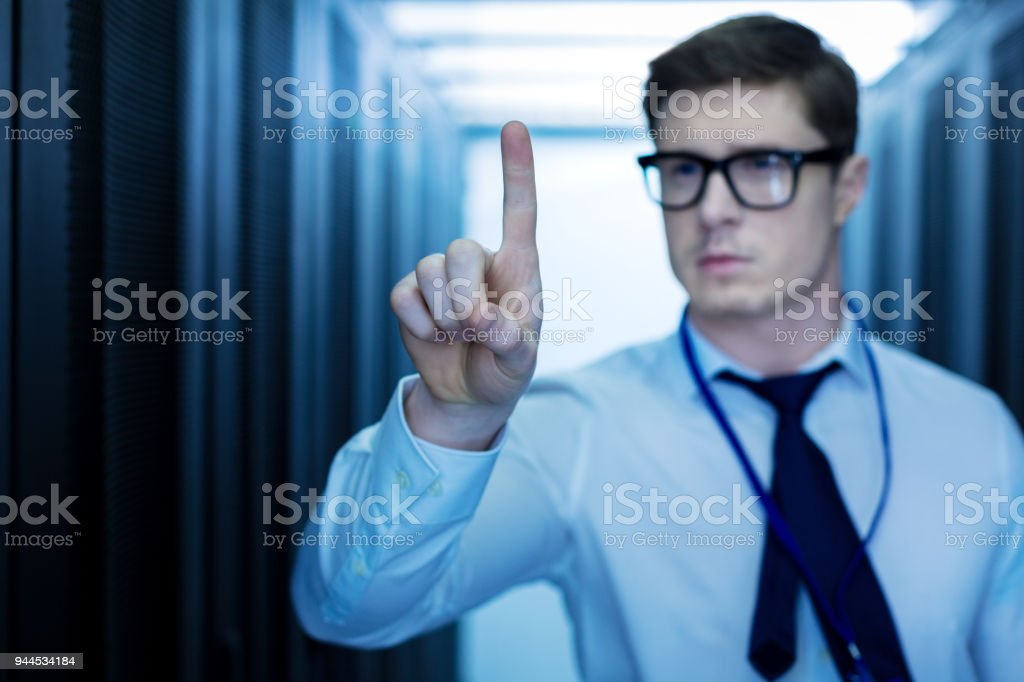 Unsmiling man pointing his finger stock photo