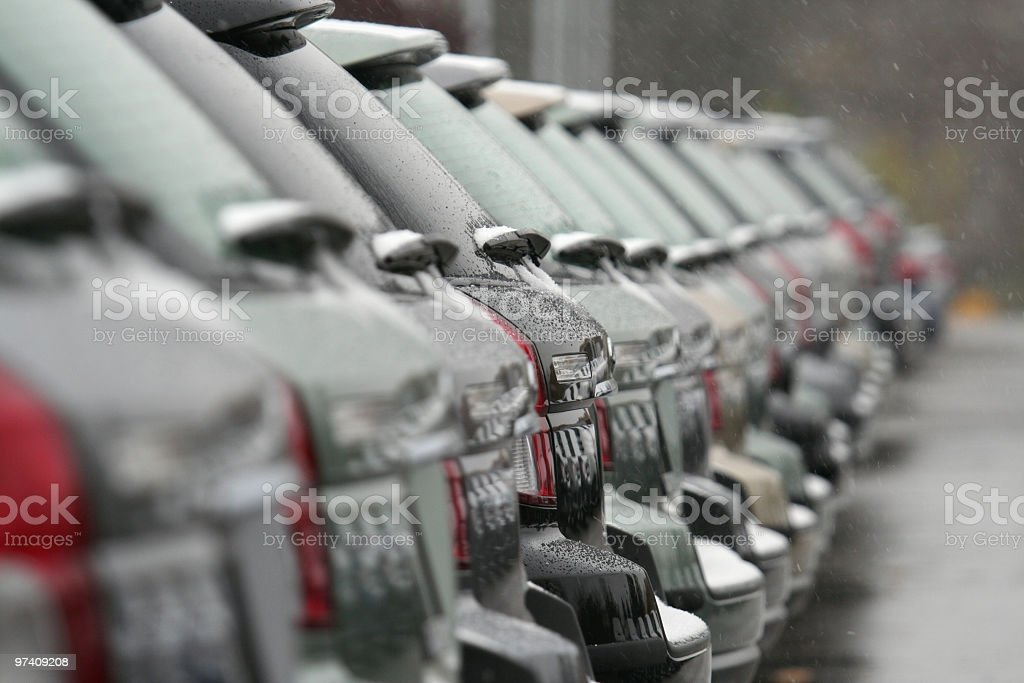 Unsold Cars For Sale In Winter Falling Snow stock photo | iStock