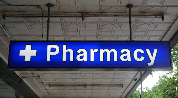 Unspecified Pharmacy neon sign above the entrance to the chemist drug store stock photo