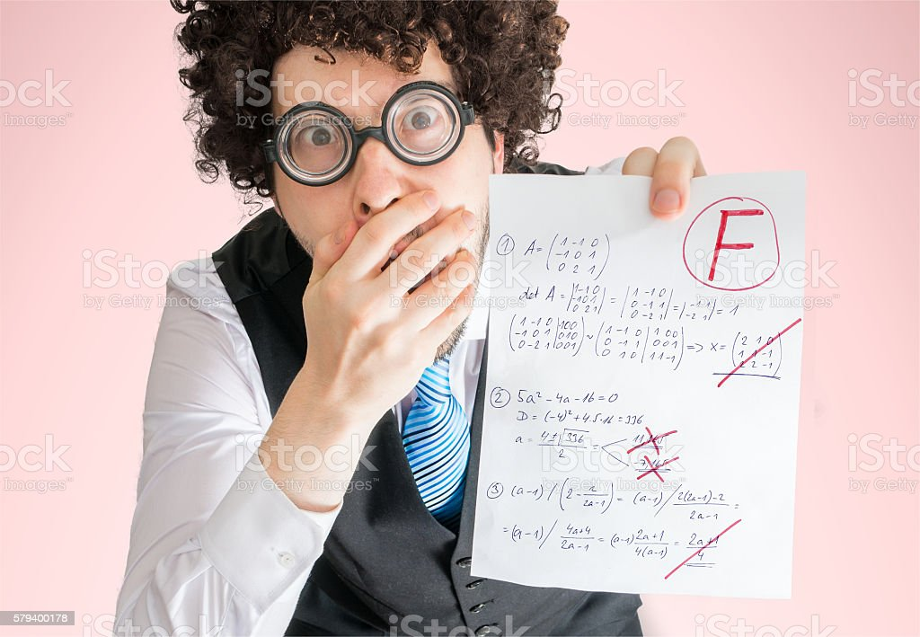 Unsuccessful student is showing math exam with bad results. stock photo