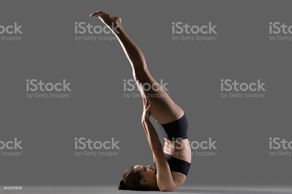 Unsupported Shoulderstand yoga pose stock photo