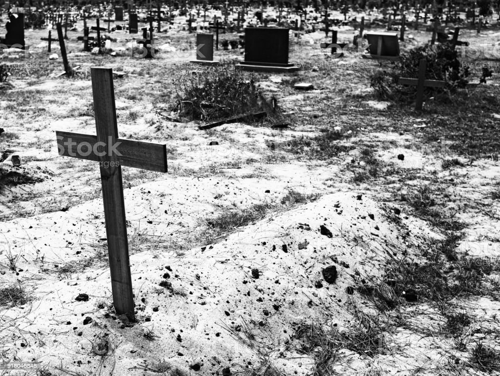 Untidy cemetery with poorly maintained graves stock photo