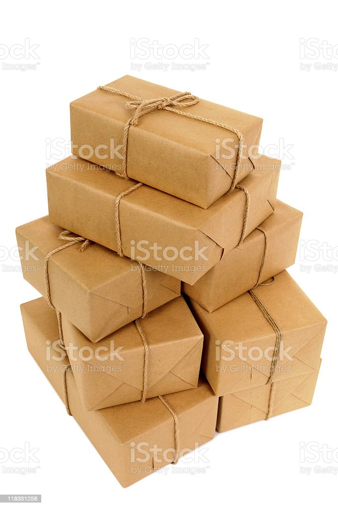 Untidy stack of brown paper packages stock photo