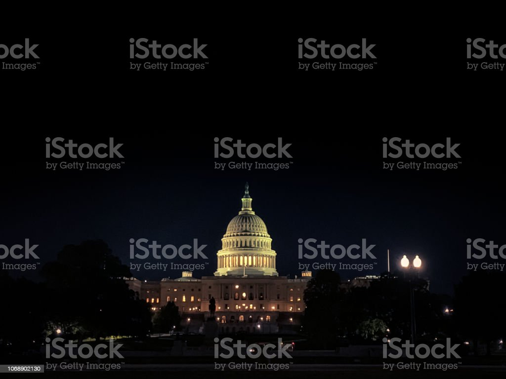 Untied States Capitol at night in Washington D.C. stock photo