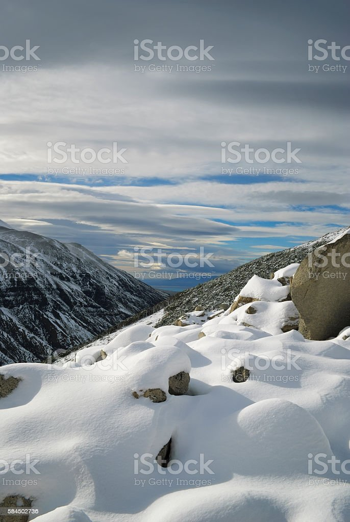 Untouched snow on the mountain slope, Torres del Paine, Chile stock photo