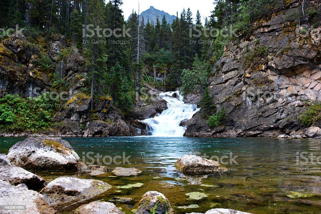 Untouched Waterfall in the Mountains stock photo