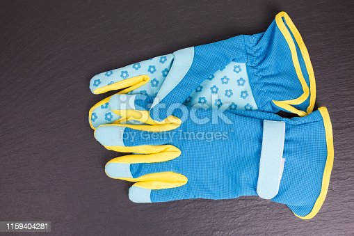 new unused gardening gloves in blue and yellow