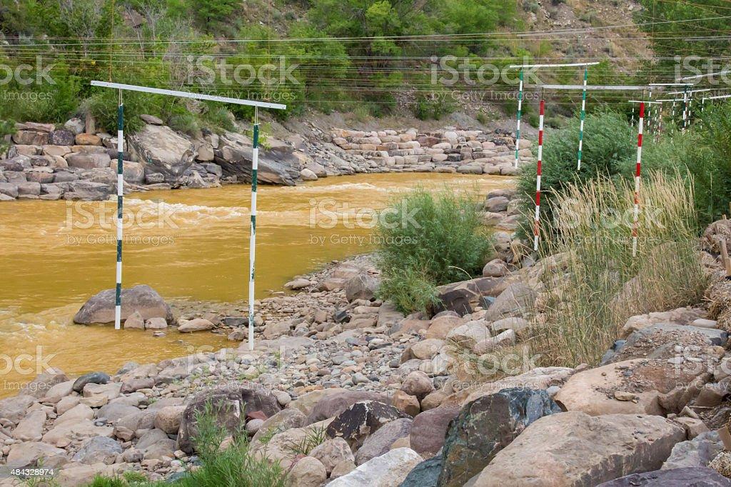 Unused slalom gates in Durango against toxic water stock photo