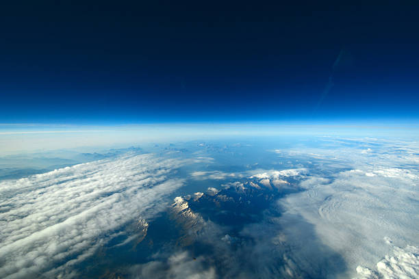 unusual aerial view of the earth and clouds. - stratosphere stock pictures, royalty-free photos & images