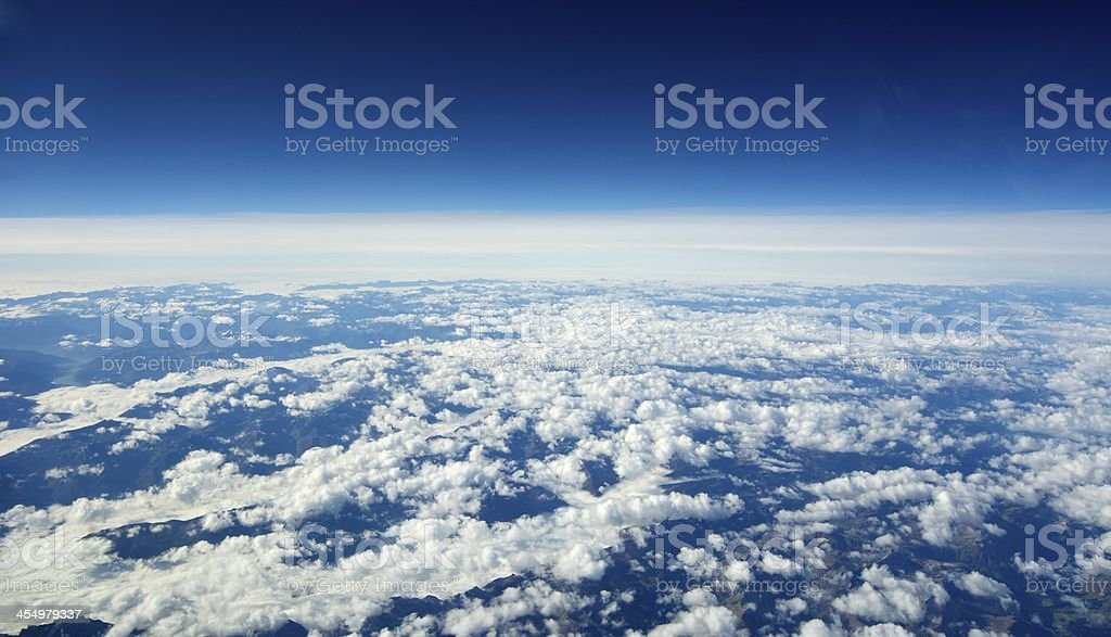 Unusual aerial view of the Earth and clouds. stock photo