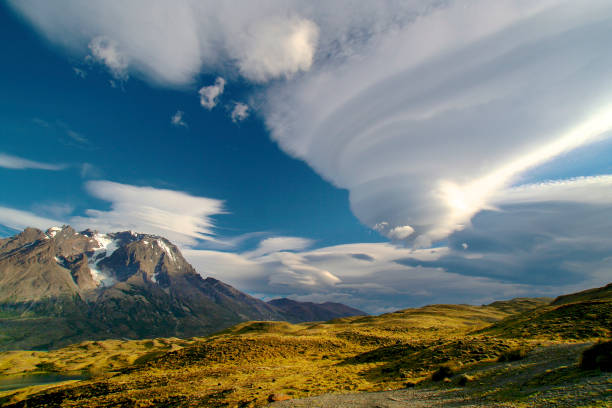 Unusual Lenticular cloud in Patagonia Unusual Lenticular cloud in Patagonia in Torres del Paine National Park lenticular cloud stock pictures, royalty-free photos & images