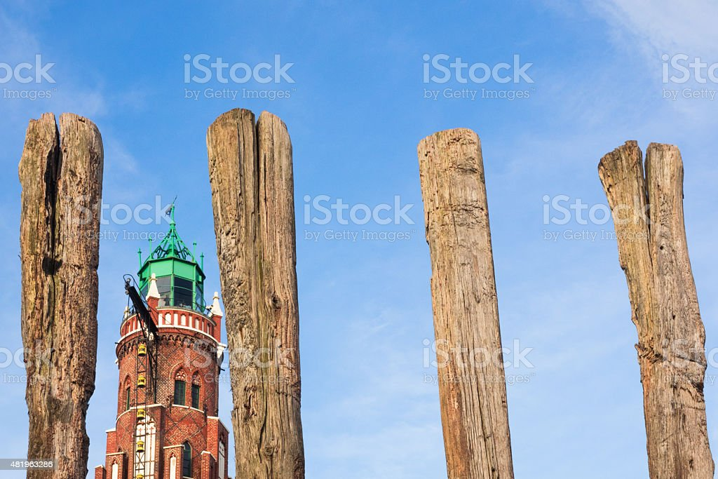 Unusual perspective of a beacon between piles stock photo