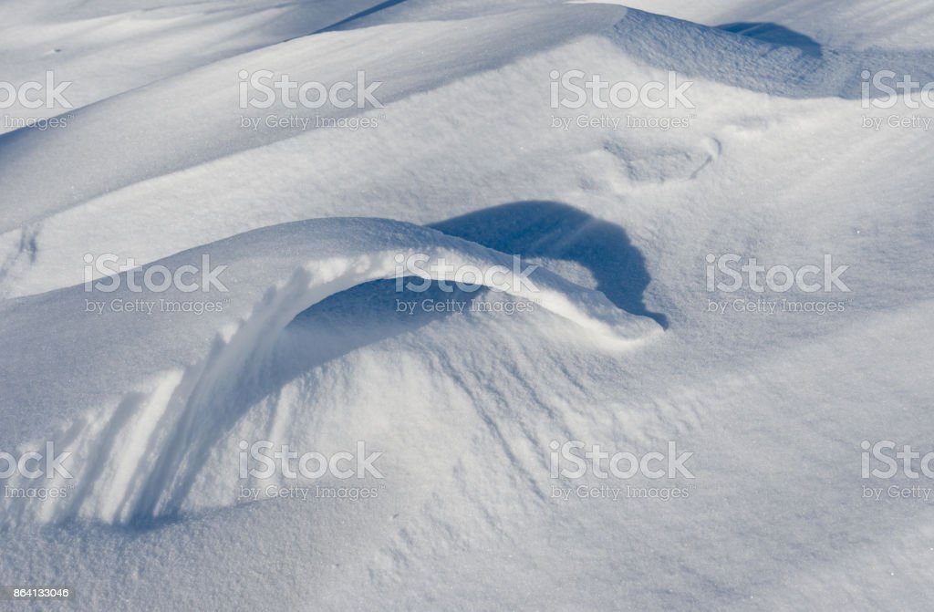Unusual shapes, light and shadows of fresh snow royalty-free stock photo
