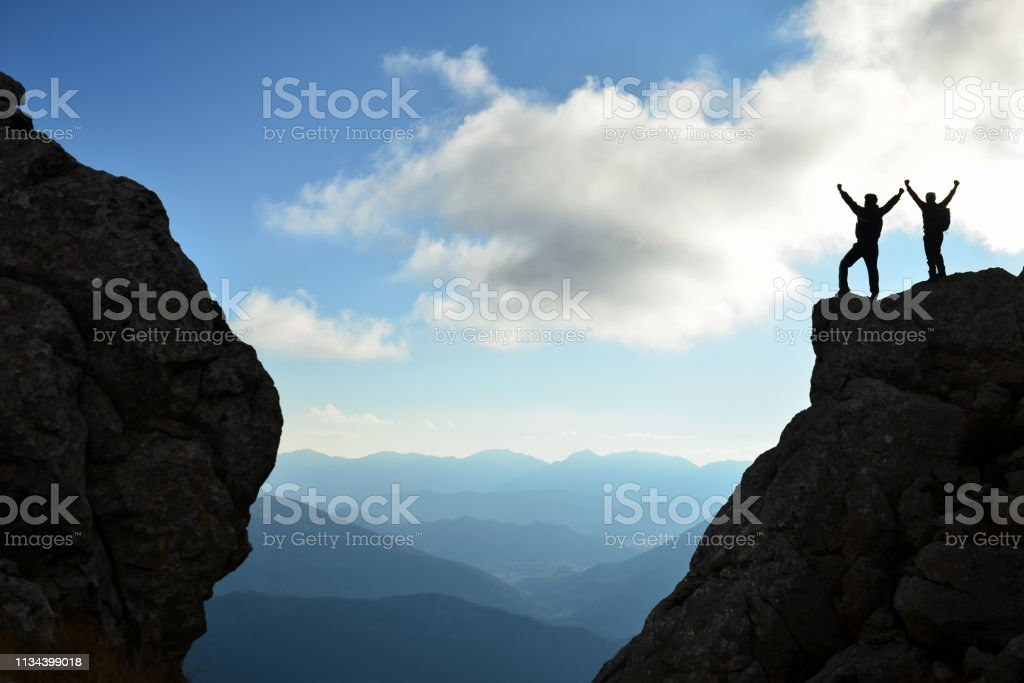 unusual success story and the happiness of determined climbers stock photo