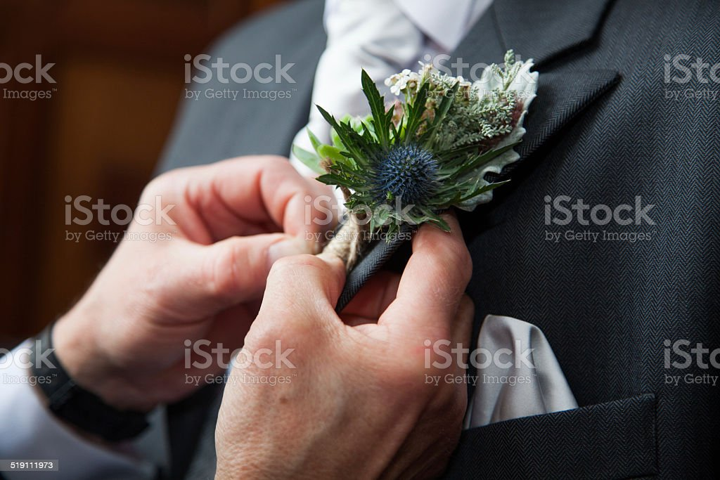 Unusual thistle and Succulent Wedding Photograph of a Buttonhole stock photo