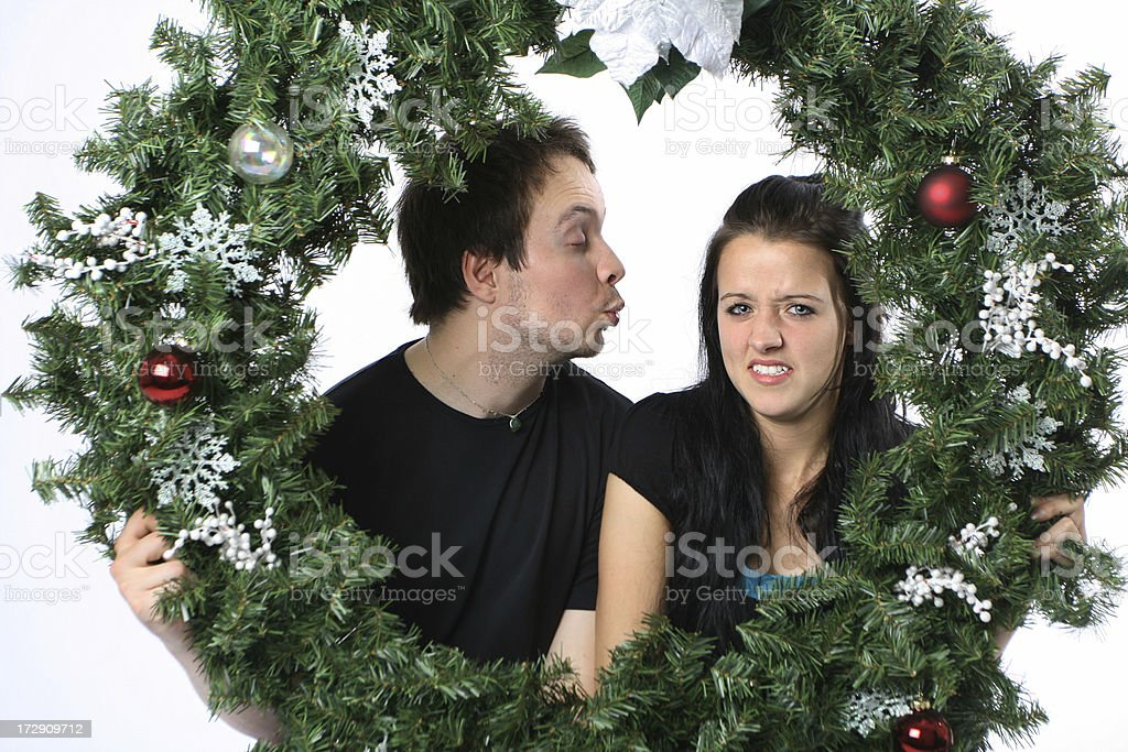 Unwanted Christmas Kiss stock photo