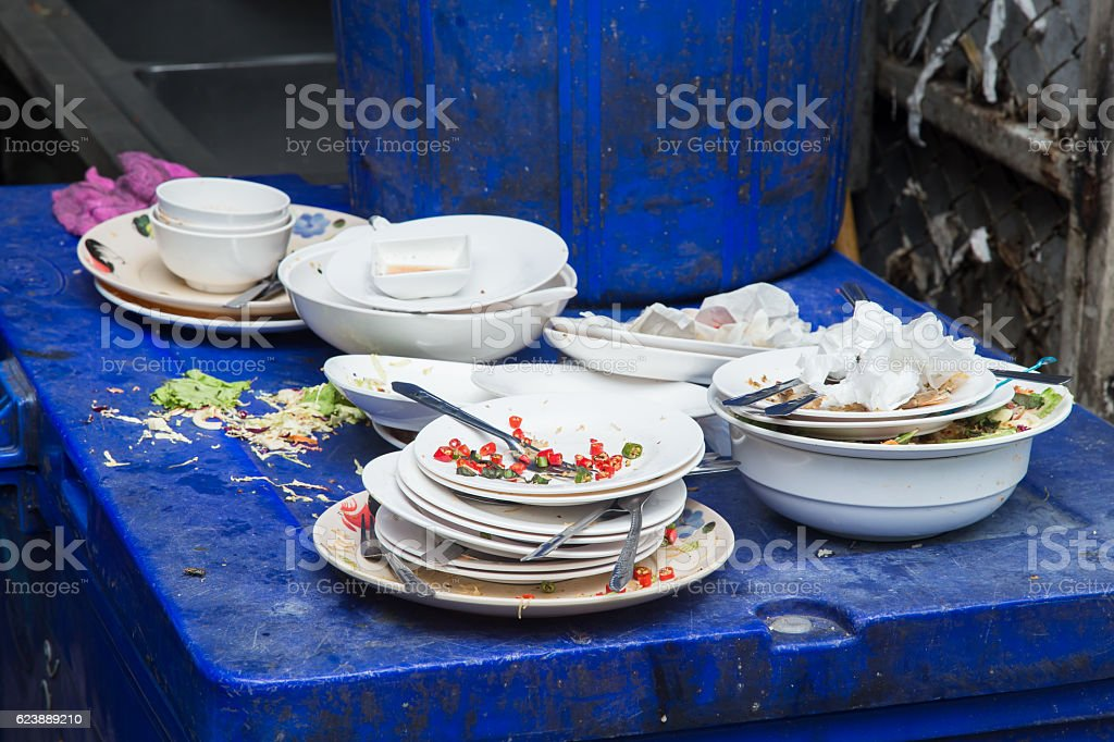 unwashed dish with food garbage unhealthy unclean dirty restaurant. stock photo