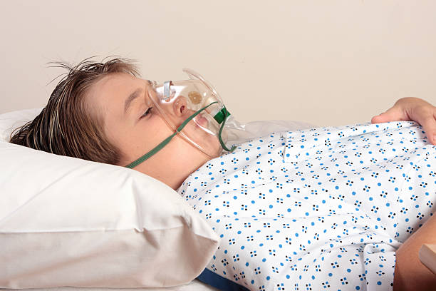 Unwell child oxygen mask  tranquilizing stock pictures, royalty-free photos & images