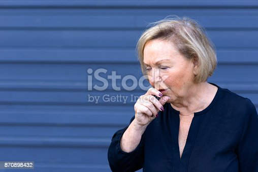 istock Unwell elderly lady having a coughing fit 870898432