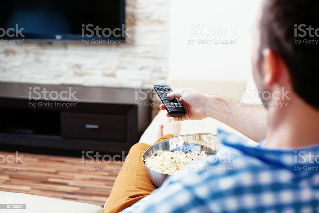 Unwinding in front of a telly stock photo