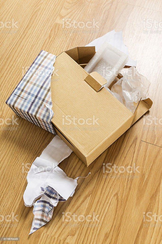 Unwrap of present stock photo