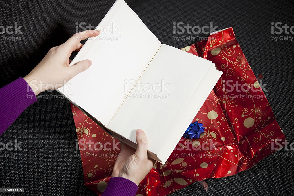 unwrapped gift book royalty-free stock photo