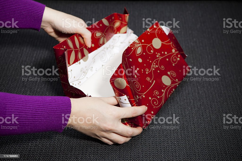 unwrapping gift stock photo