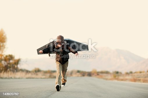A young boy takes to the sky with his rocket pack. Plenty of great copy space for your concept.