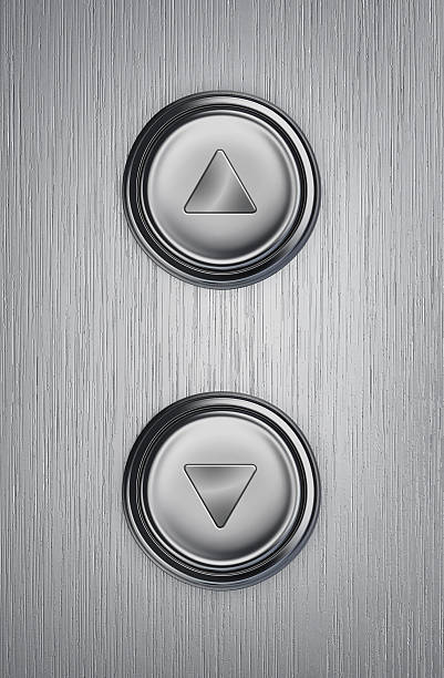 up and down elevator buttons - button stock photos and pictures
