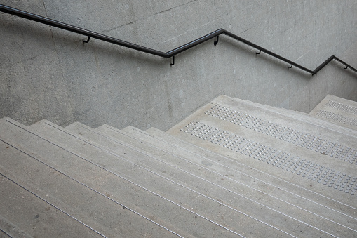 Up and down stairs with handrails for balancing while climbing the stairs Safety building design concept