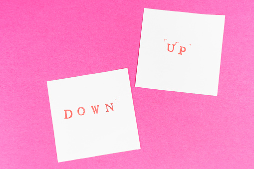 istock up and down words printed on two sheets 1050665740