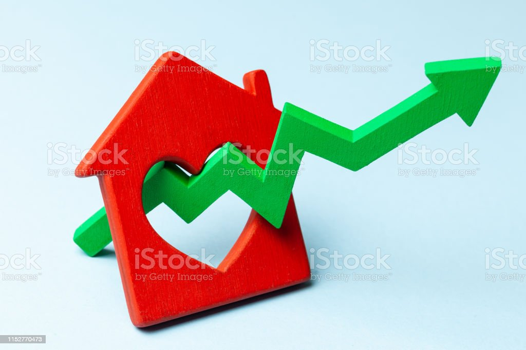 Up arrow and house on blue background. Market growth in real estate...