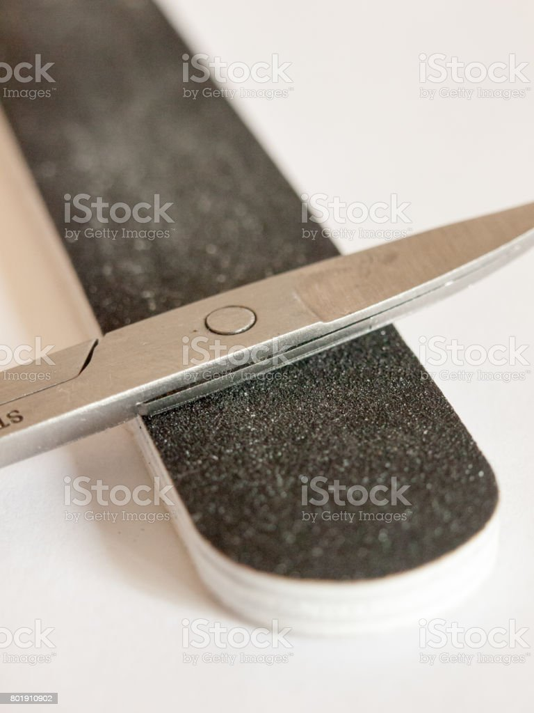 up close nail file and scissors detail macro stock photo