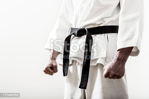 Karate black belt get tied.