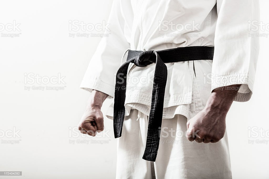 Up close of a martial arts black belt worn on ready fighter stock photo