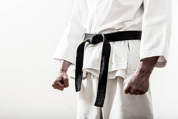 up close of a martial arts black belt worn on ready fighter - karate stock photos and pictures