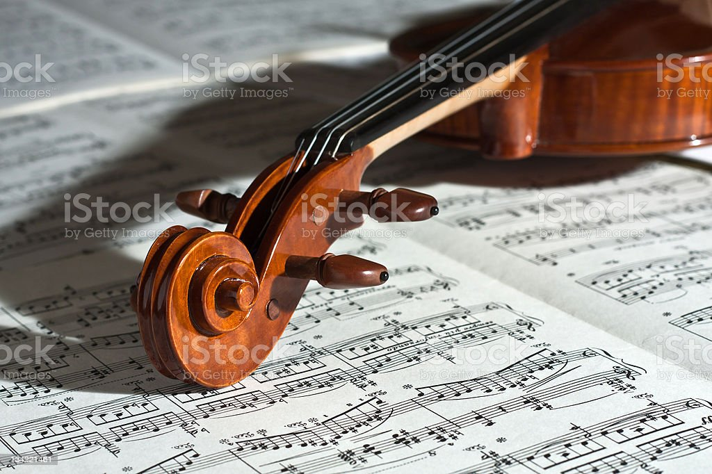 Up close of a violin on a music sheet stock photo