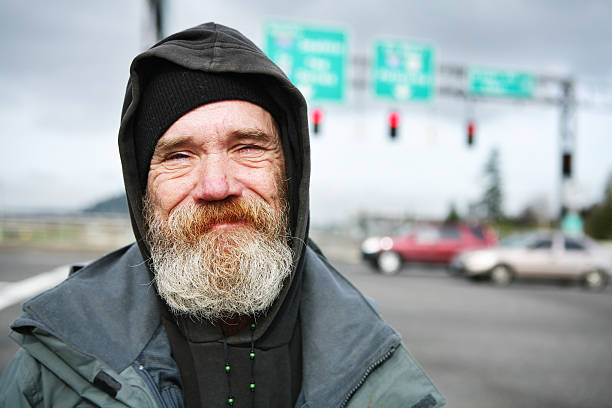 up close photo of a homeless man - homelessness stock photos and pictures