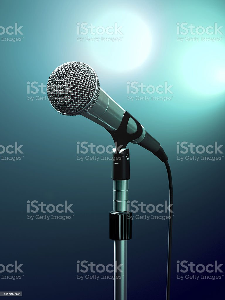 Up close photo of a microphone mounted on a stand stock photo