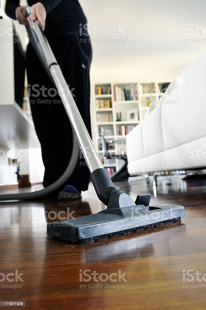 Up close photo of a vacuum cleaning laminate flooring stock photo