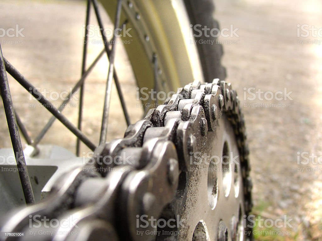 Up close shot of bike chain with rear tire royalty-free stock photo