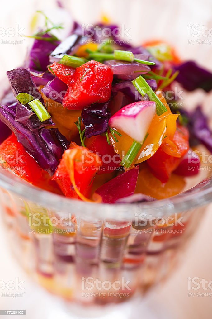 Up close view of a Russian salad, served in a glass bowl  royalty-free stock photo