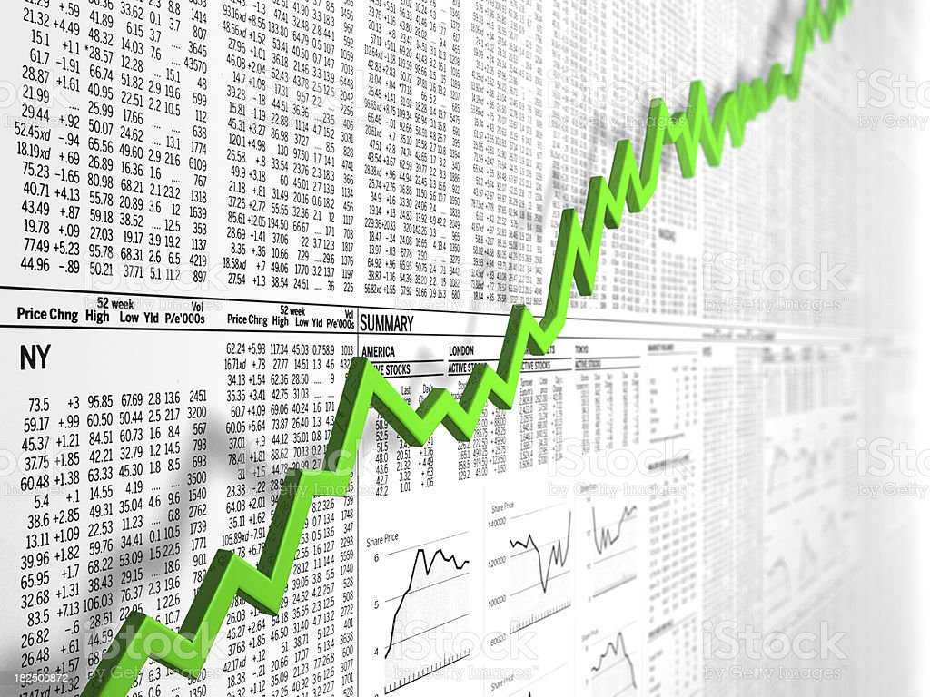 Up graph in front of newspaper stock market tables royalty-free stock photo