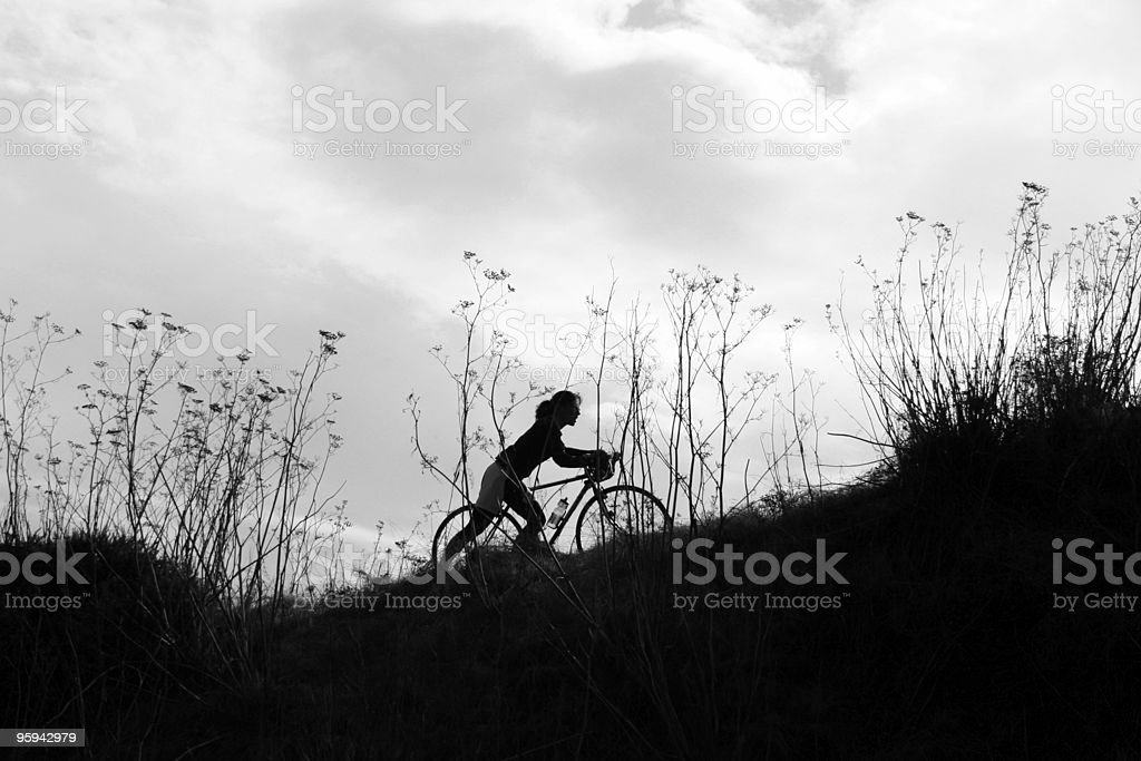 Up Hill Bike Climber royalty-free stock photo