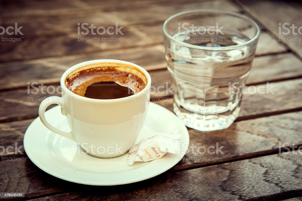 "Сup of Turkish coffee ""espresso"" with cookies and glass of water."