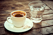 """Сup of Turkish coffee """"espresso"""" with cookies and glass of water."""