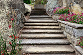 Staircase through a rock cutting in a large garden.