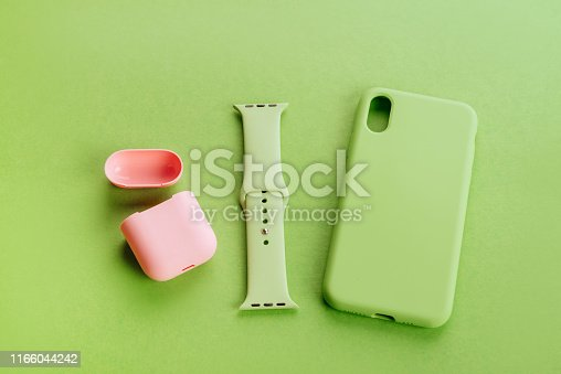 Up to date technology.Top view of diverse personal accessory laying on the green background