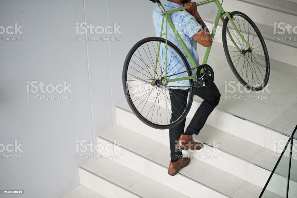 Up to the office with his trusty bicycle stock photo